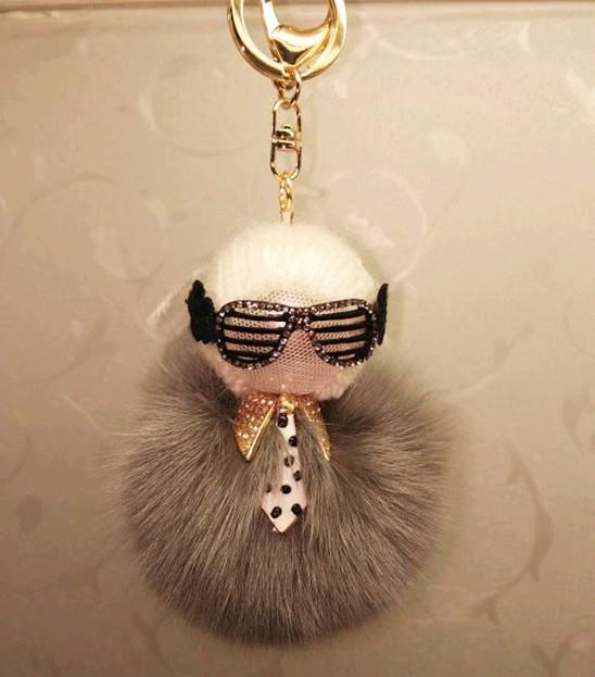 A la venta Karl Monster Real pompón de piel cadena de la mano del encanto del bolso de la bolsa colgante encanto del monedero cadena dominante del coche accesorios para la mujer