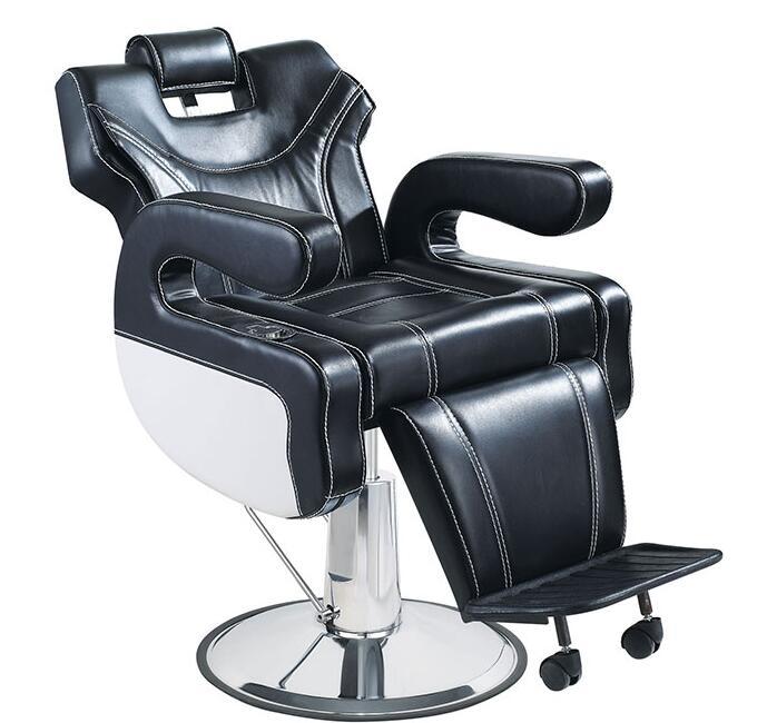 Fauteuil de coiffure pour salon de coiffure. Une chaise de barbier haut de gamme multifonctionnelle. Chaise de MassageFauteuil de coiffure pour salon de coiffure. Une chaise de barbier haut de gamme multifonctionnelle. Chaise de Massage