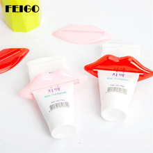 FEIGO 2 Pcs Red Lip multifunction squeezer  toothpaste squeezer Home Tube Rolling Holder Squeezer Easy Toothpaste Dispenser F106 aarhon 4 f106 1293