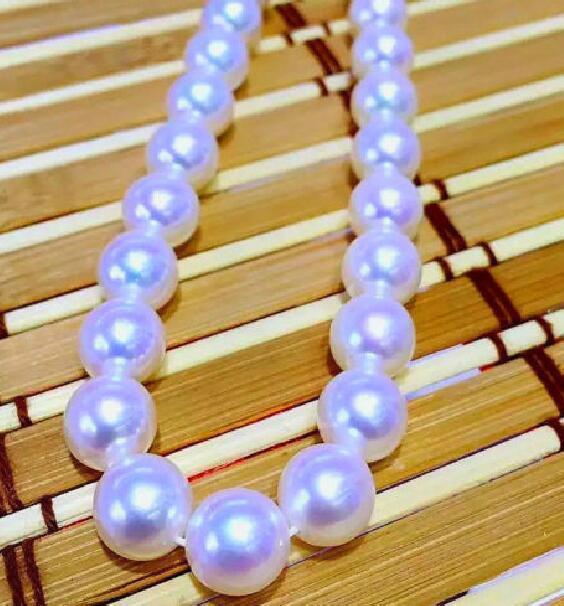 Collier de perles rondes blanches deau douce naturelles 18 11-12mm 925 argentCollier de perles rondes blanches deau douce naturelles 18 11-12mm 925 argent