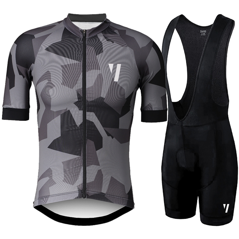 Black and White cycling jersey with black pants
