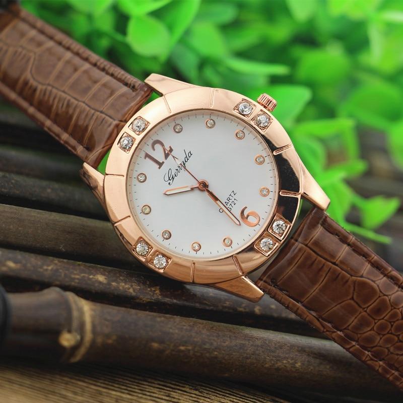 Gerryda 721 fashionabla dam klockor, PVC läderband, Rhinestone deco fodral med guldplätering, kvarts rörelse, avslappnad stil design