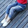 Nuevos vaqueros de las muchachas Regular Ripped Jeans para los niños Unisex Pantalon Jean Enfant Garcon vaqueros 6J026