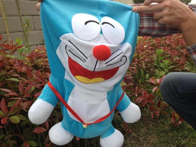 50 cm Doraemon juguetes de peluche de la piel, sostener una vela A dream doll chaqueta, gran oso de peluche abrigo de piel