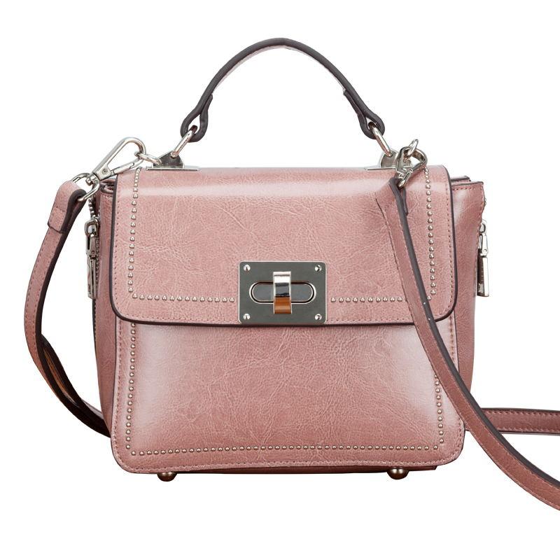The latest Fashion Leather Woman Handbag 2018 Small Bag Buckle Rivet Tide Portable Single Shoulder Bag Xiekua Package