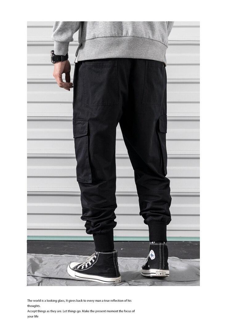 joggers calças laranja preto muitos bolsos calças