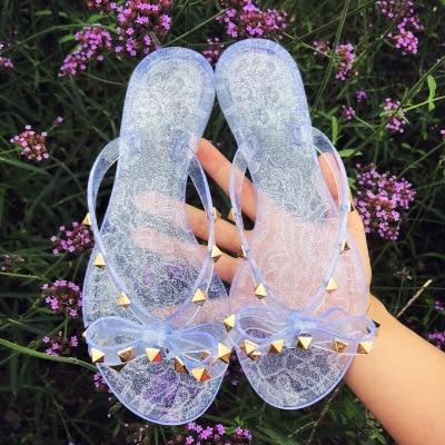 Femmes Pantoufles V Gelée Chaussures Femmes Tongs Arc Stud Femmes Sandales Plat été Dames Plage Pantoufles étanche String Sandale