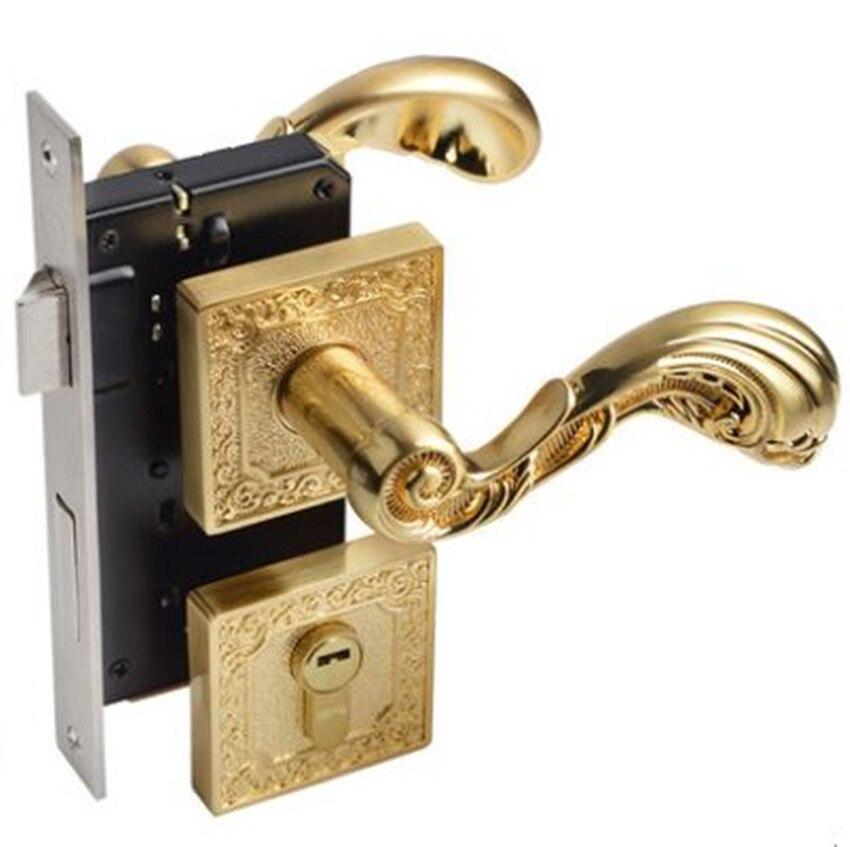 La poignée d'intérieur muette de mode moderne verrouille les serrures de porte en bois solides de chambre à coucher d'or balayées avec la serrure fendue de clé