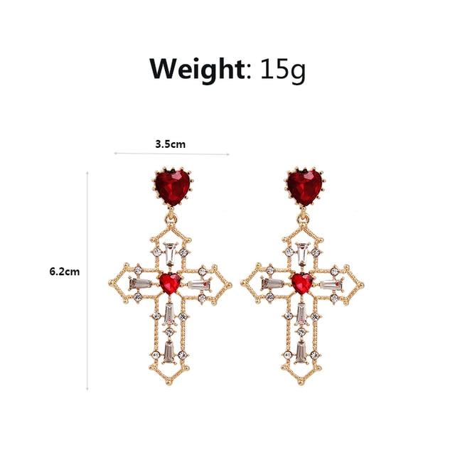Женские серьги подвески в виде сердца с красным кристаллом
