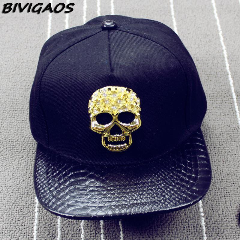 2016 nuevos hombres de la moda del cráneo del metal serpiente de cuero hip  hop Cap Gorras de béisbol SnapBack sombreros para hombres mujeres negro oro  en ... afc43d03e5f
