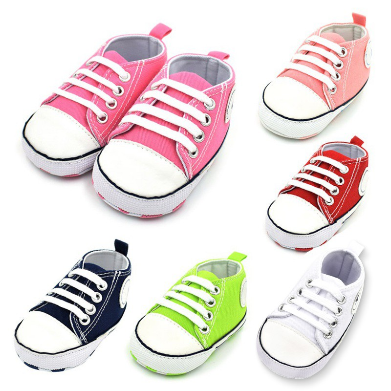 pink, black, green, white, red, and peach laced baby and toddler first walker shoes