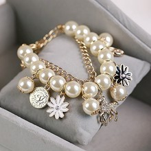 Hot Fashion Double Layers Simulated Pearl Beaded Gold Metal Chain Bangle Crystal Horse Flower Pendant Charm Bracelet for Women(China)