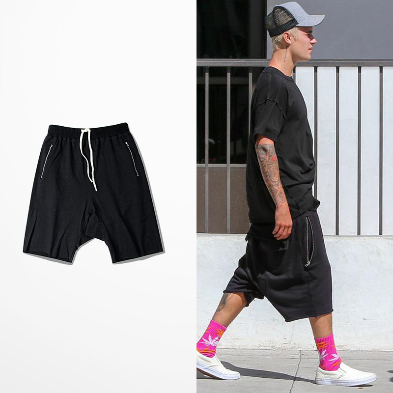 Men harem shorts hiphop kanye west justin bieber style short sweatpants elastic waist zipper pockets man sporting shorts homme