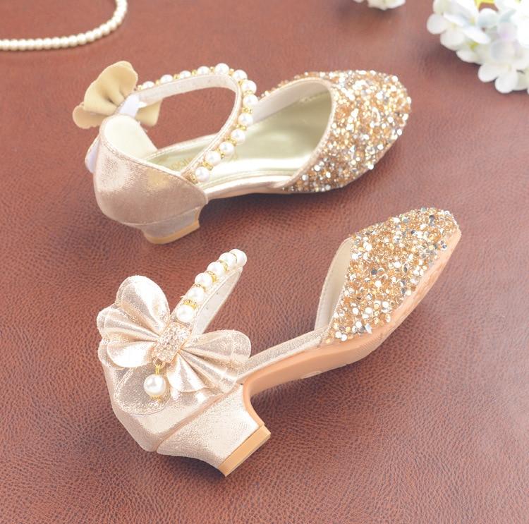 Image 2 - Детские сандалии из искусственной кожи с пряжкой на ремешке, обувь для девочек, блестящие сандалии на высоком каблуке с бантом, обувь для вечеринок, подарок, 2019Сандалии   -