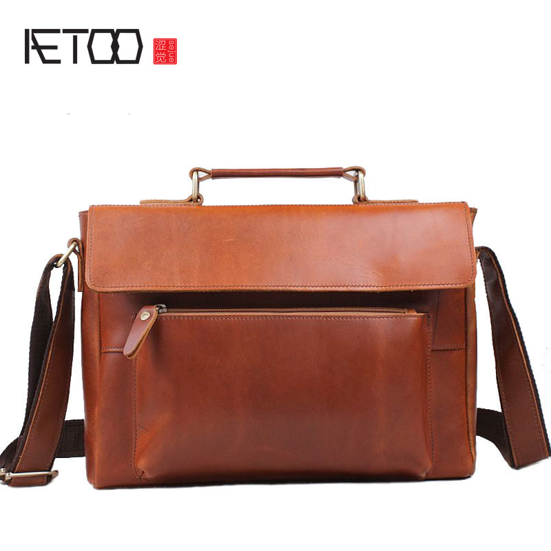 AETOO Import the first layer of cowhide mad horse leather A4 handbag handbag shoulder twist fashion tide cool men bag aetoo first layer of leather korean version of the tide ladies oil wax leather handbag ladies shoulder messenger bag