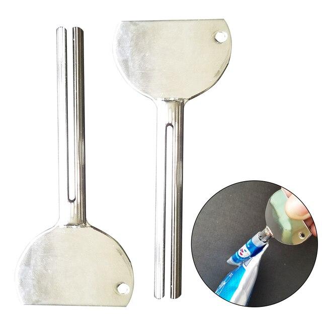 1 pz In Acciaio Inox Tubo di Crema Spremere Dispenser Dentifricio Spremiagrumi d