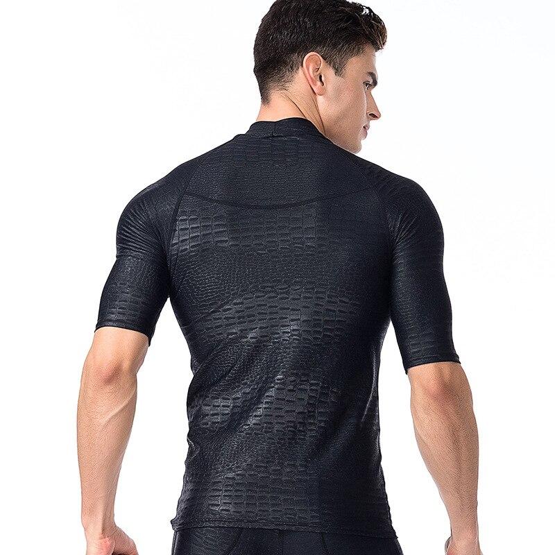 e478871e5fe Aliexpress.com   Buy 2017 Plus Size Surfing Swimming Tops Men Beach Sun UV  Protection Swimwear Rash Guard Man Short Sleeve Basic Skins Tees Black from  ...