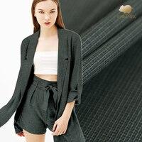 Dark green wool fabric worsted lattice wool fabric autumn wool suit jacket fabric fashion clothing fabric wholesale wool cloth