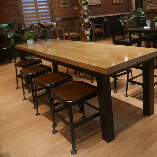 Dinette combination of solid wood, wrought iron tables and