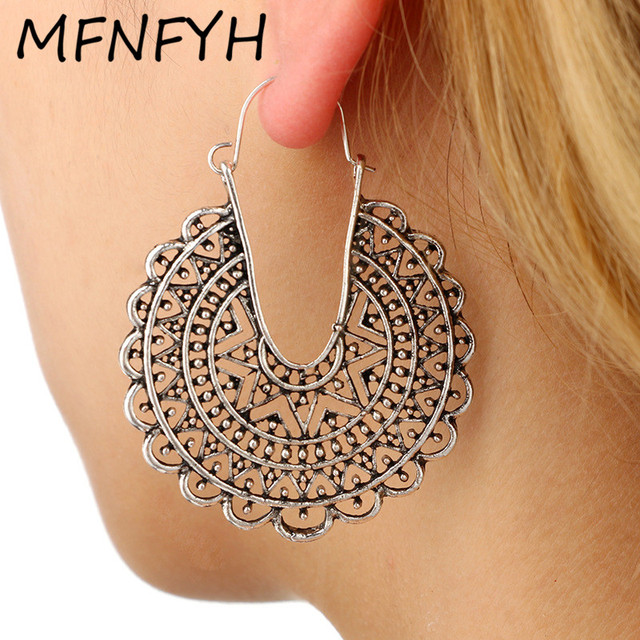 MFNFYH Tribal Antique Silver Hollow Flower Hoop Earrings for Women Vintage  Bohemian Punk Big Round Earring da208bc467a3