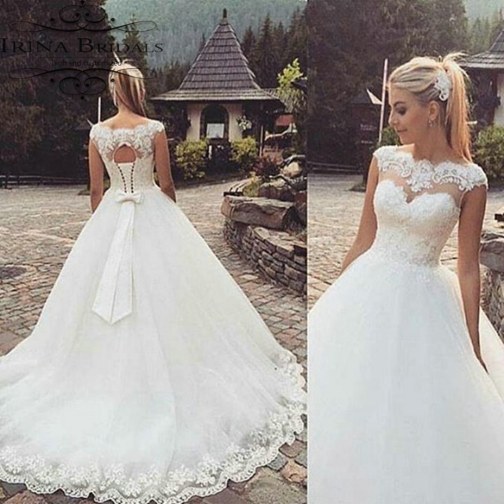 Free Shipping High End Russia Style Cap Sleeve Lace Appliques Butterfly Bow Ball Gown Wedding Dress In Dresses From Weddings Events On