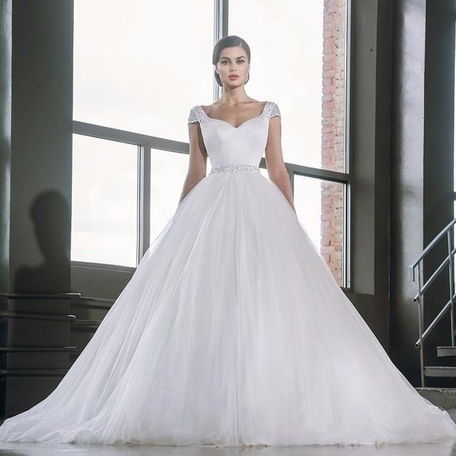 2017 Sexy Backless Vestidos de Casamento Da Princesa vestido de Baile Cap Mangas Com Bead Vestidos De Noiva Pérolas Frisado Tule vestido de Noiva