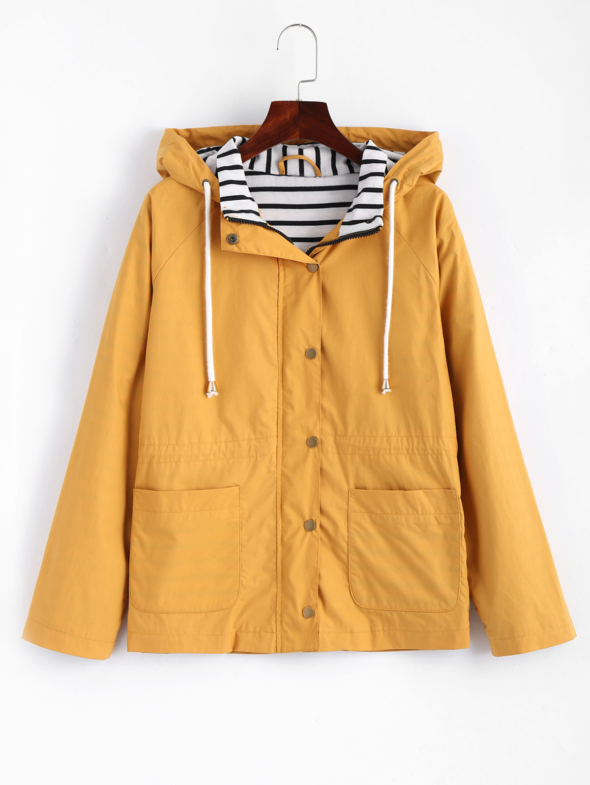 8476870cfcb78 This mustard jacket features a zip up front with snap button closure and  two big pockets