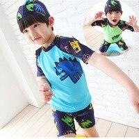 Crianças Boy Swimsuit Bodysuit Traje do Dinossauro Dos Desenhos Animados 2 Peças Fatos de banho Protetor Solar Praia Com Cap Crianças Meninos Swimwear 2-13Y