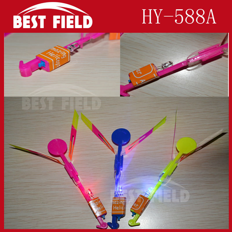 free shipping200pcs/lot make LOGO red blue flash light Elastic Toy Gift Flash Rotating Flying Arrow Rocket Helicopter LED Light