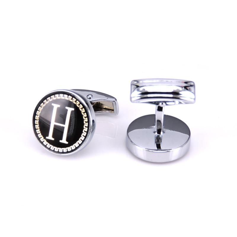 bouton de manchette lettre h