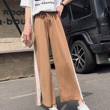 все цены на Elastic Waist Drawstring Sweatpants Women Casual Wide Leg Pants Loose Trousers Women Black Striped Side Split Female Plus Size онлайн