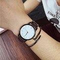Venta caliente precio de La Promoción de Moda Pareja Dial Redondo Diseño Simple Banda reloj de Cuarzo reloj de Pulsera Reloj Hombres Mujeres regalo de la muchacha
