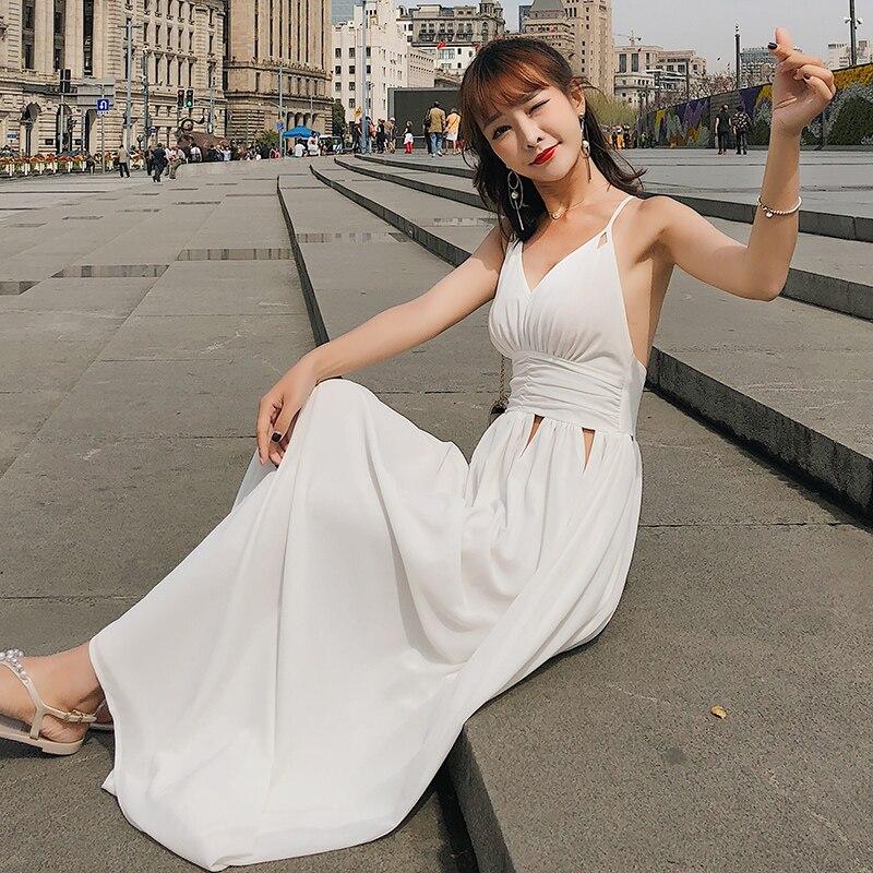 Été nouvelle couleur pure vacances robe col en V blanc grand pendule taille haute vide robe de mariée jupe de plage