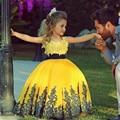 Amarillo Vestidos 2016 del vestido de Bola Niñas Vestidos Del Desfile Apliques Cap Manga Vestidos de Niña