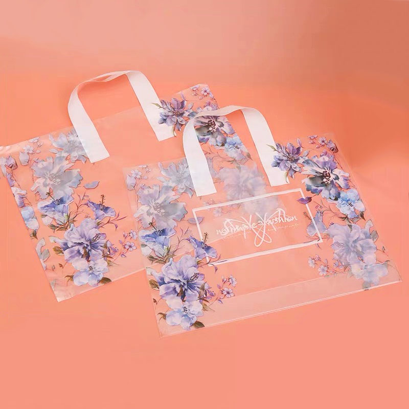 New 50pcs/lot Clear <font><b>Plastic</b></font> <font><b>Gift</b></font> <font><b>Bag</b></font> <font><b>With</b></font> <font><b>Handles</b></font> Purple Flower Printing Clothing Shopping <font><b>bags</b></font> for packaging big image