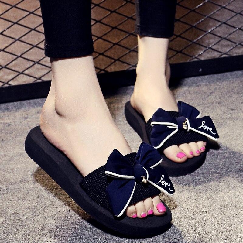 designer flip flops with bows