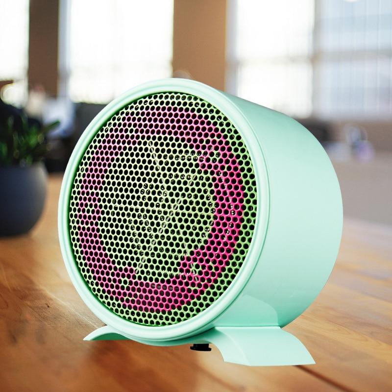 все цены на Free Shipping Mini Small Electric Heater PTC ceramic heating Warm hand Desktop Portable Hot Air Heater Office Heater Gift