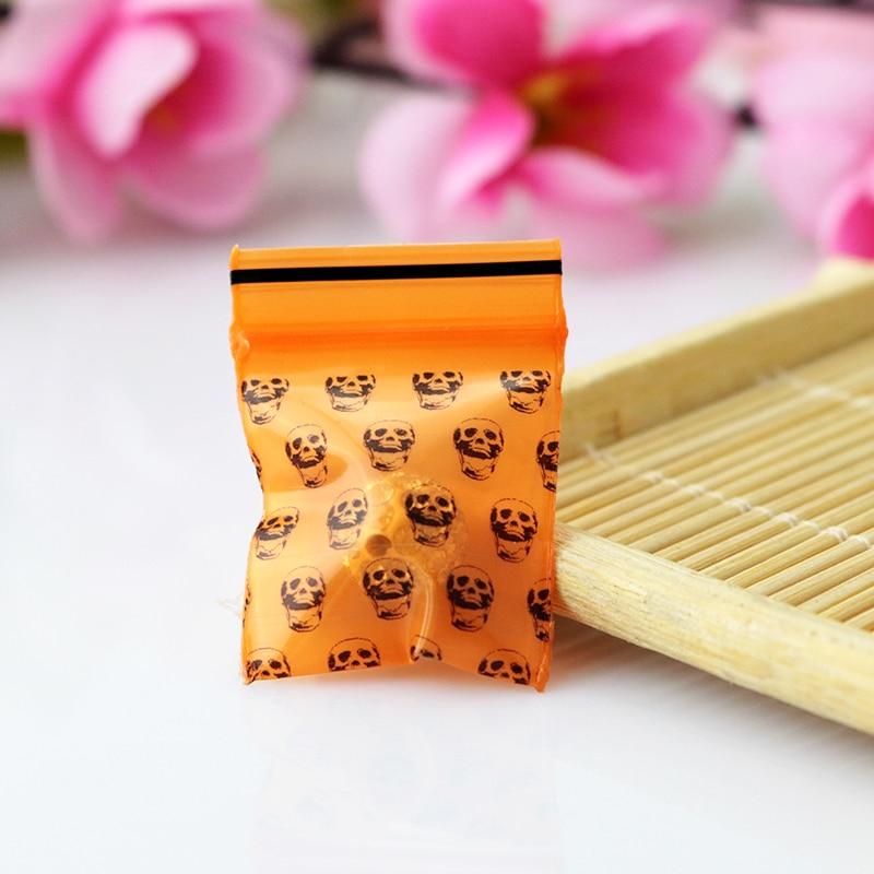 great bulk price 1000pcs small orange skull pirnt poly ziplock thick plastic reclosable zipper bags 25