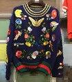 Nuevo invierno pasarela pesado bordado pájaro mariposa patrón de suéter engrosamiento