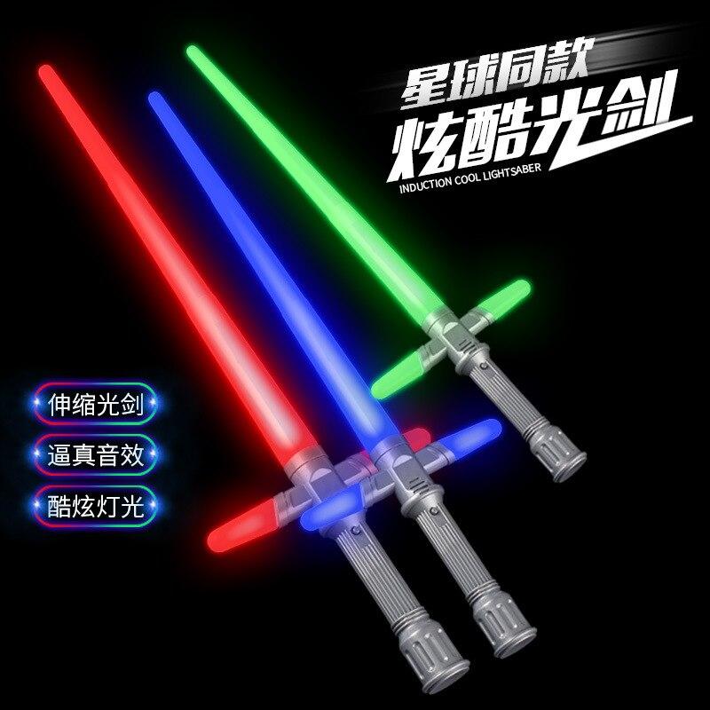 La nueva estrella guerras e7 sable viene con los efectos de sonido y una brillante Cruz espada láser que las escalas de los niños espadas de juguete