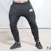 2016 marke Neue Goldmedaille Fitness Beiläufige Elastische Hosen Stretch Baumwolle herren Hosen Körper Ingenieure Jogger Bodybuilding