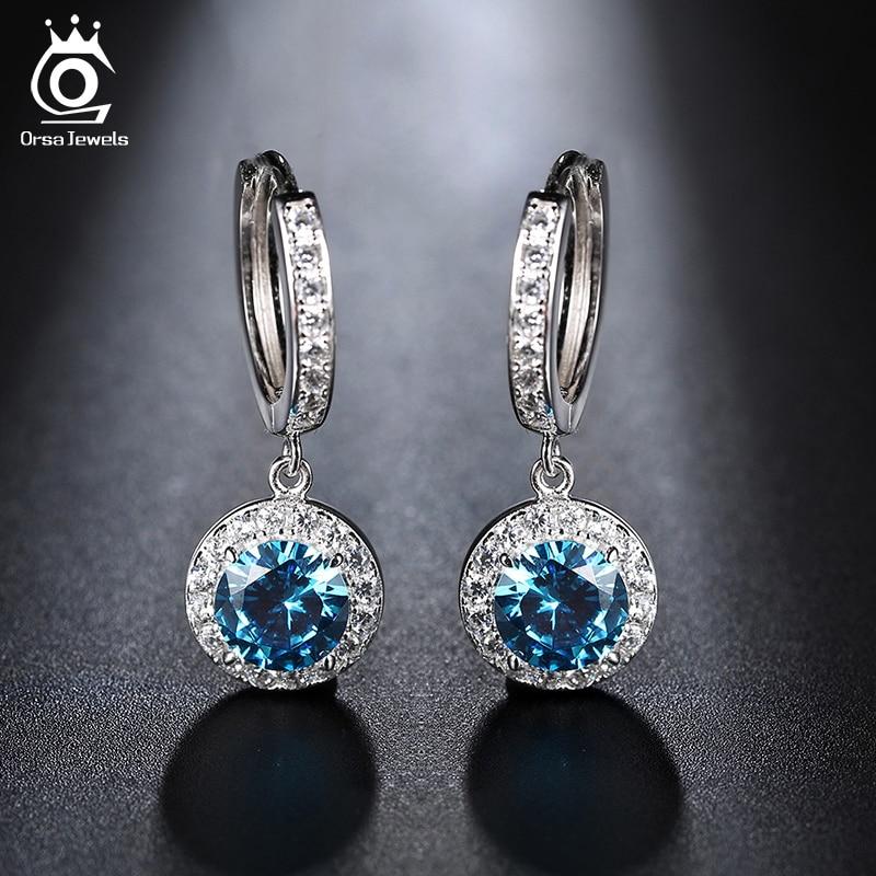ORSA JEWELS nieuwste luxe zilveren kleur en rose goud kleur oorbellen met 1,8 karaat Oceaan blauwe zirconia oorbel voor vrouwen OE160
