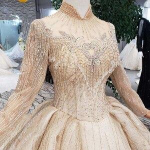 Image 4 - HTL245 Lange mouwen trouwjurken champagne hoge hals kralen bridal jurken baljurk keyhole terug jurk 2019 promotie