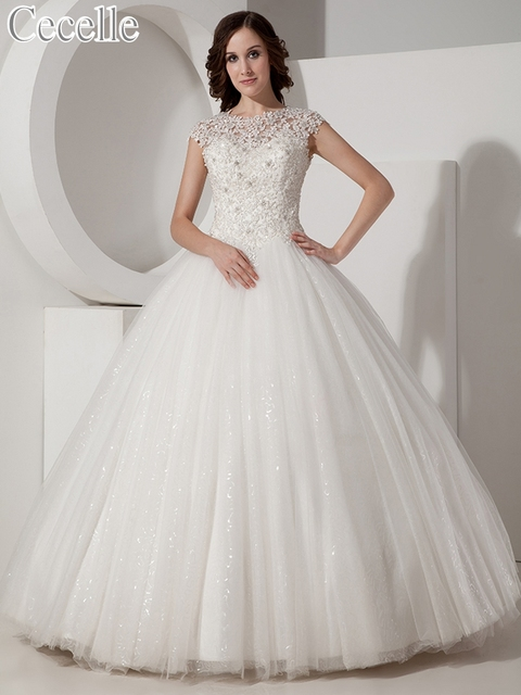 2019 Ball Gown Lace Tulle Modest Wedding Dresses With Cap Sleeves Princess  Ivory Floor Length Corset b12e39047f82