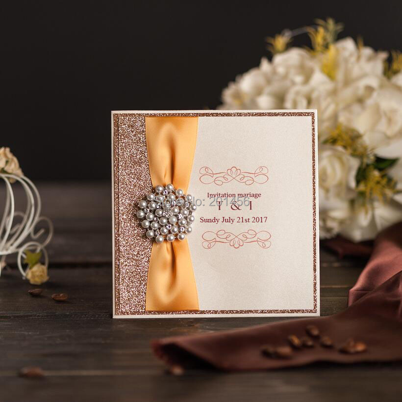 Elegant gold wedding invitations card with ribbon and brooch elegant gold wedding invitations card with ribbon and brooch customized bridal shower marriage birthday party invitations tky315 in cards invitations from filmwisefo