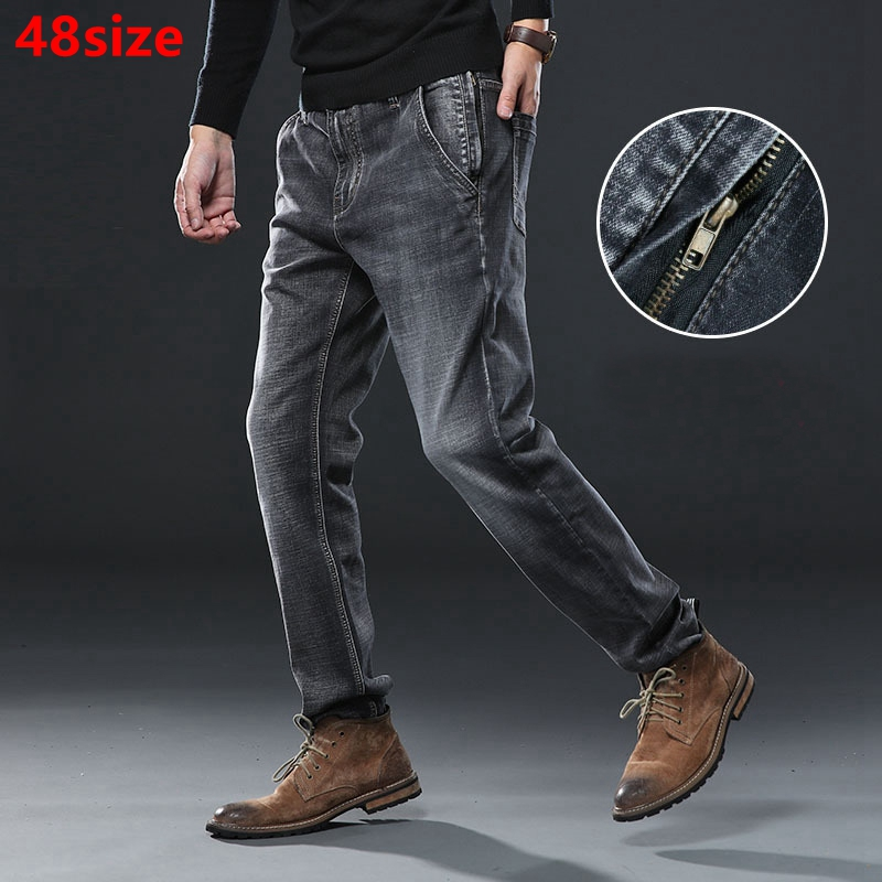 Autumn thick high elastic   jeans   men's loose anti-theft pockets plus fertilizer to increase big size pants dark gray