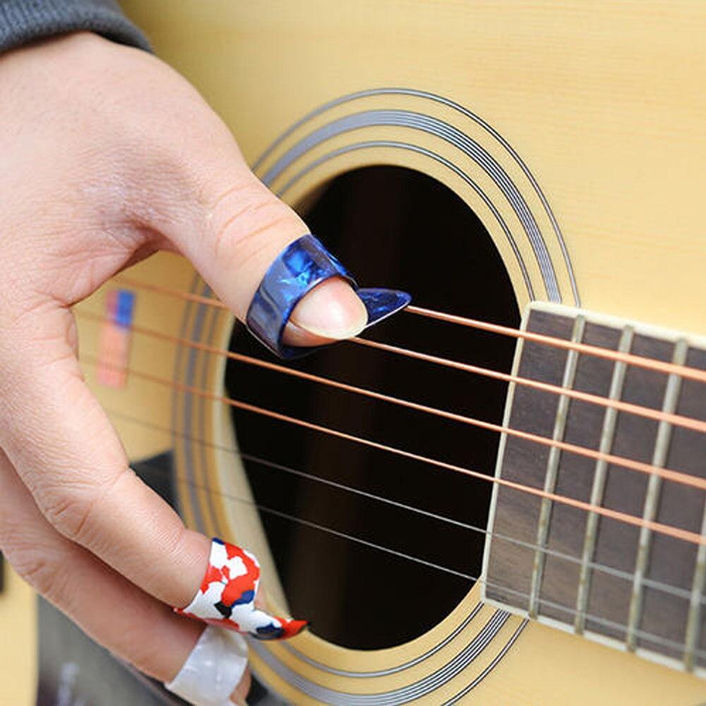 3 finger picks and 1 thumb pick 6