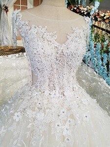 Image 2 - LS00174 انظر من خلال الظهر الديكور قصيرة الأكمام الدانتيل الكرة ثوب الزفاف derss كاتدرائية قطار فاخر