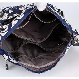 Image 5 - באיכות גבוהה עמיד ניילון נשים כתף תיק אופנה פרחוני דפוס נשי תיק רב כיסים בנות Leasure שליח תיק