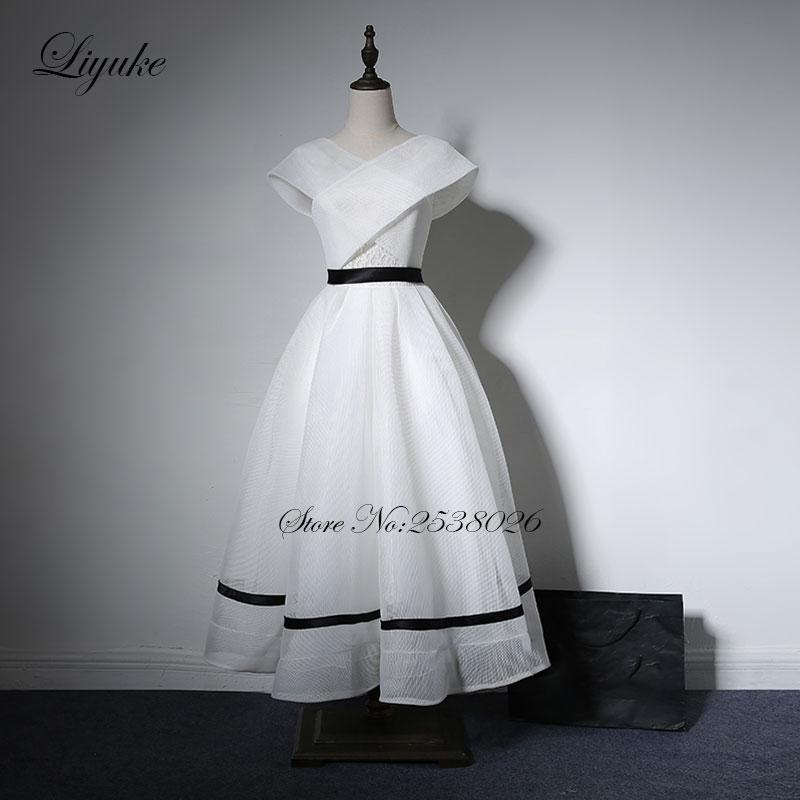 Liyuke White Color Prom Dress With V Neckline A Line Cap Sleeve Tea Length formal Dresses